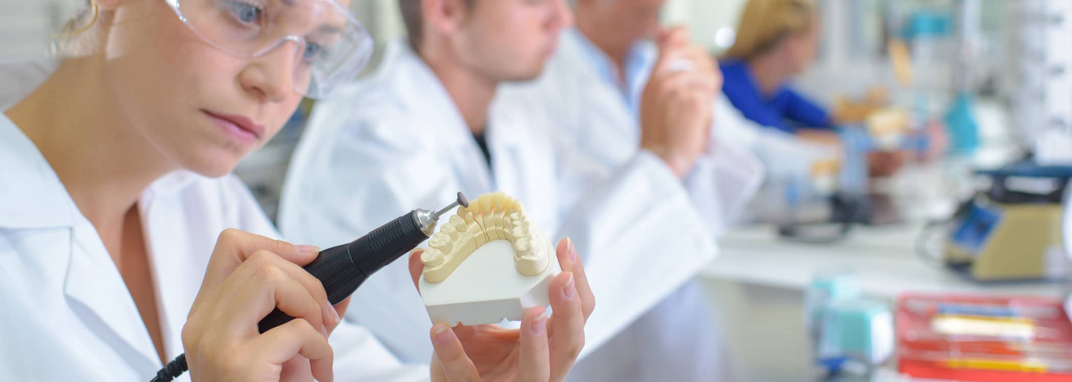 Image of professionals making dentures.