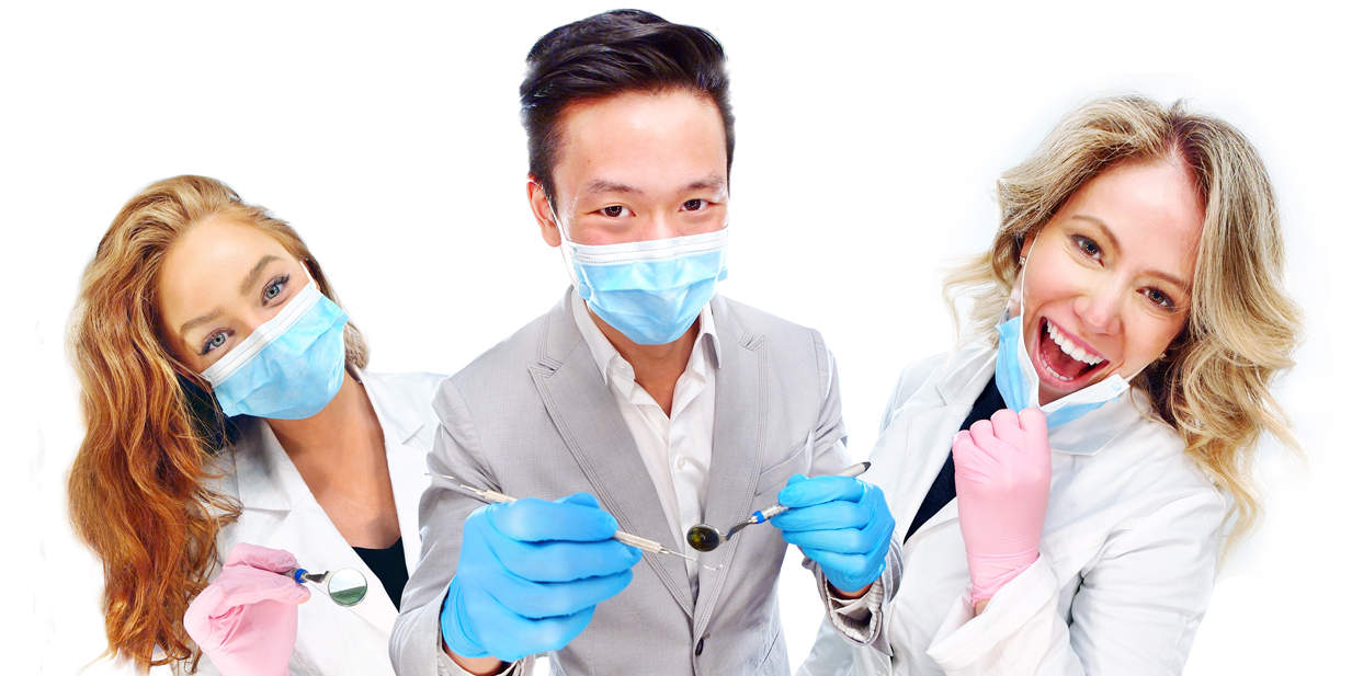 3 Smiling dental professionals with masks.